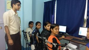 4 young women learn computer skills in vocational computer training course in Kolkata India