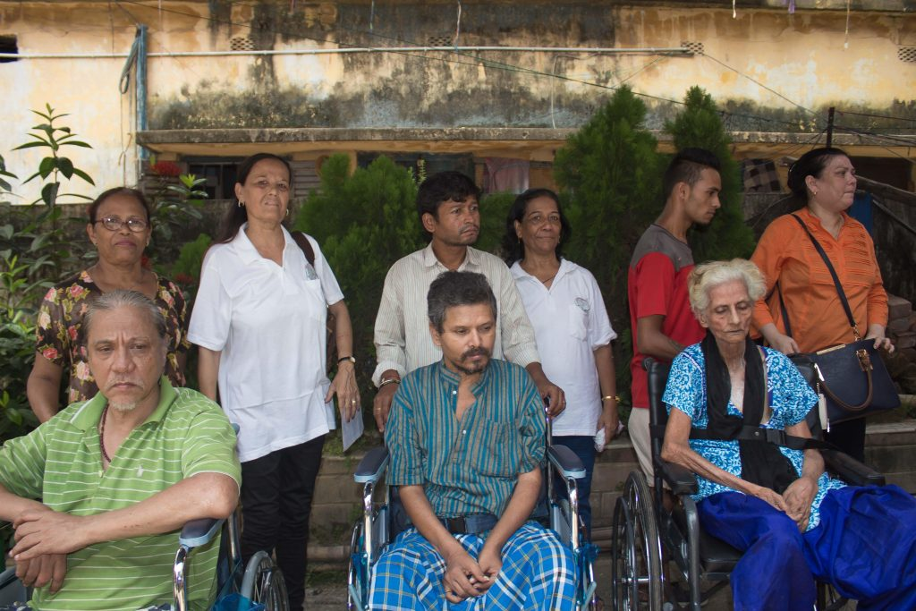 donors give wheelchairs to india's disabled poor including these three adults