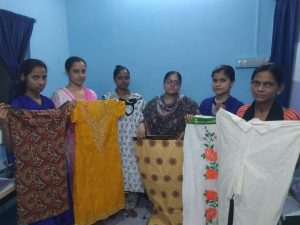 vocational tailoring students display clothes they've made in class